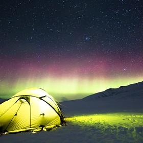 Cuddle up in a sleeping bag under the aurora - Bucket List Ideas