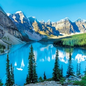 See the reflection of the spectacular Rocky Mountains in Moraine Lake at Banff National Park, Canada - Bucket List Ideas
