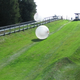 Zorb at the location where the sport was invented in New Zealand - Bucket List Ideas