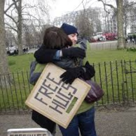Hold up a free hugs sign in a big city - Bucket List Ideas
