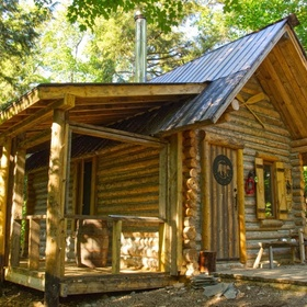 Rent a log cabin in the woods for vacation - Bucket List Ideas