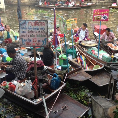 Go to a floating market and indulge on all kinds of street foods - Bucket List Ideas