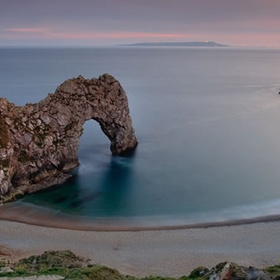 See the  Durdle Door in England - Bucket List Ideas