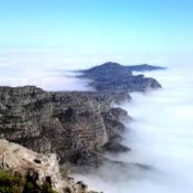 Take the cable car up Table Mountain and view the clouds from above - Bucket List Ideas