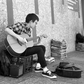 Busk with my brother at a market - Bucket List Ideas