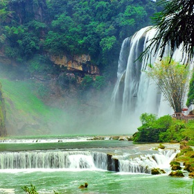 Stand under the Huangguosha waterfall in China - Bucket List Ideas