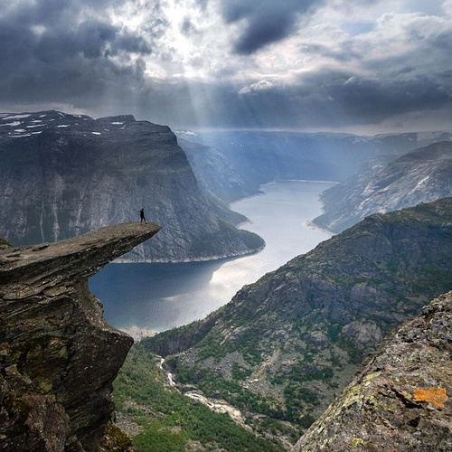 Stand on Trolltunga rock in Norway - Bucket List Ideas