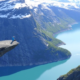Stand at the tip of Trolltunga Cliff - Bucket List Ideas