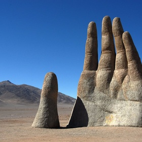 High five the giant hand in Chile - Bucket List Ideas