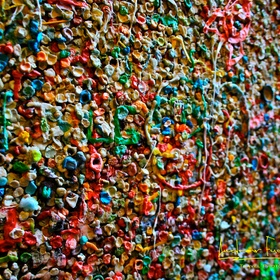 Put a piece of bubble gum on the Market Theater Gum Wall in Seattle - Bucket List Ideas
