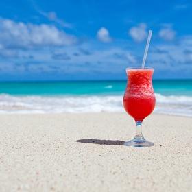 Drink cocktails on a tropical beach - Bucket List Ideas