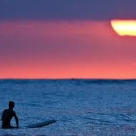 Watch a Sunrise from a Surf Board - Bucket List Ideas