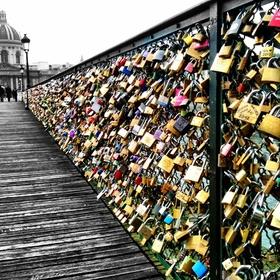 Attach a lock on the Pont de l'Archevêché in France - Bucket List Ideas