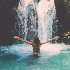Swim in the pool at the bottom of a waterfall - Bucket List Ideas