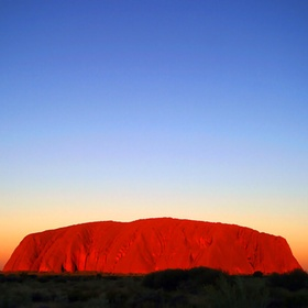 Have a glass of wine during a sunset at Uluru - Bucket List Ideas