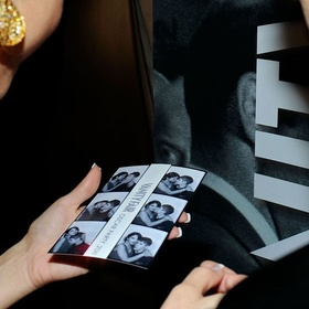 Take Cute Kissing Pictures in a Photobooth - Bucket List Ideas