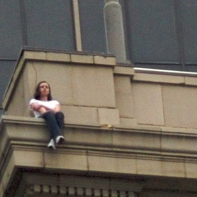 Sit on the edge of a tall building in NYC - Bucket List Ideas