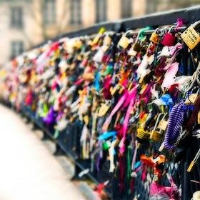 Attach a lock into a love bridge - Bucket List Ideas